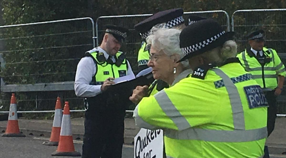 Older Quaker being arrested at DSEI