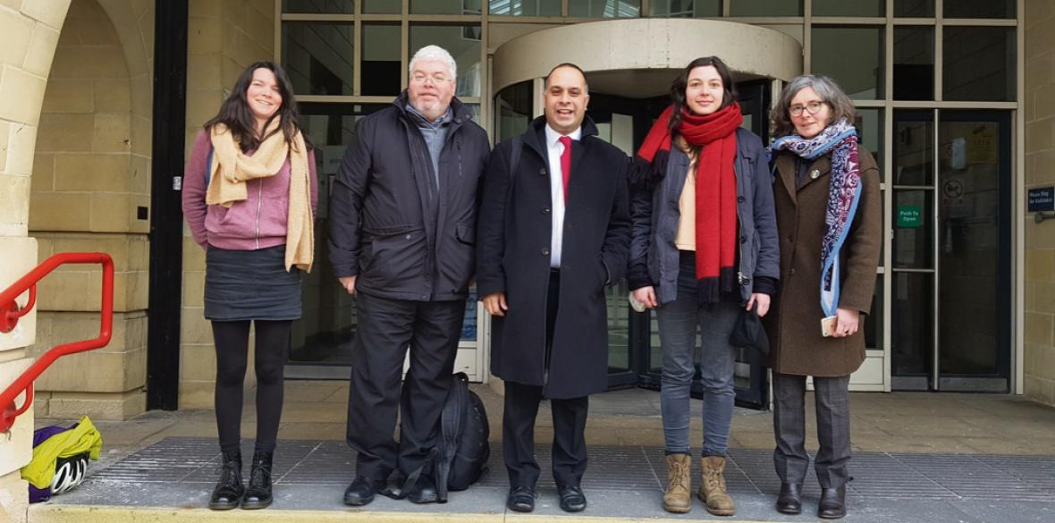 The four defendants and their solicitor outside court at an earlier hearing.