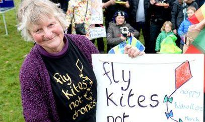 Penny Walker with a banner reading 'Fly kites, not drones'
