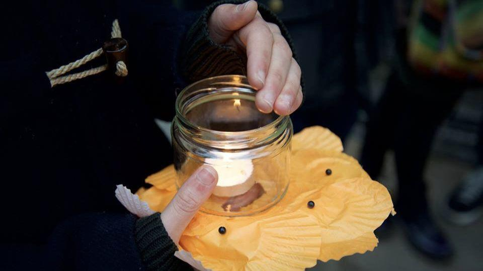 A candle held at a previous 'Remember Refugees' event