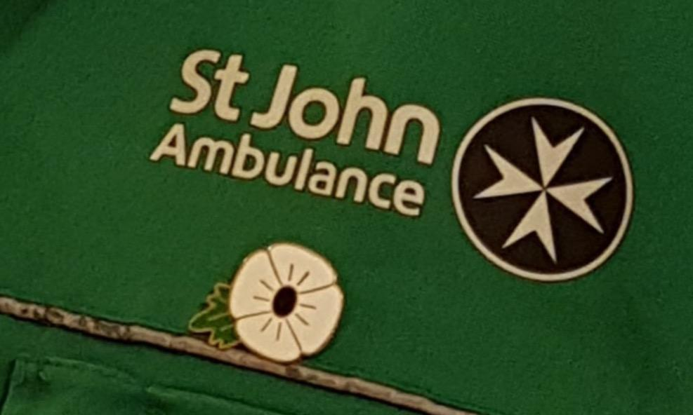 White poppy on St John Ambulance uniform