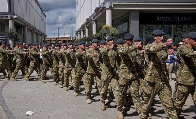 UK troops marching through the street on Armed Forces Day