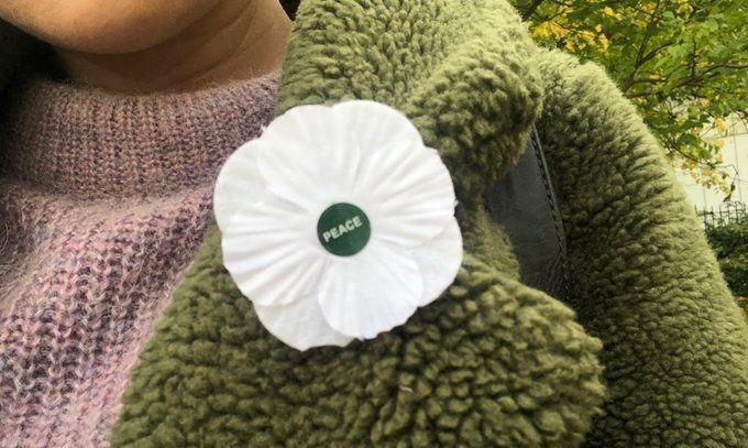 White poppy attached to a jacket