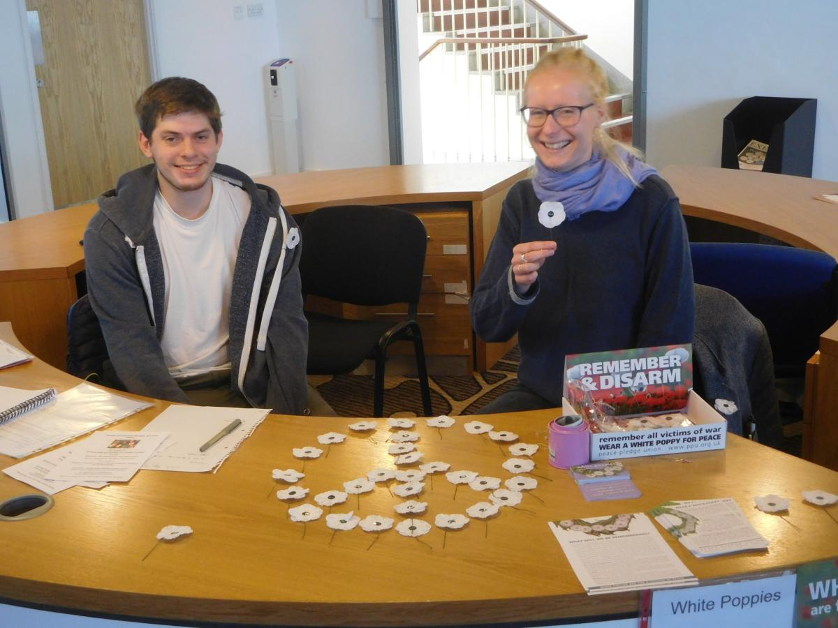 Students selling white poppies at Exeter University this year