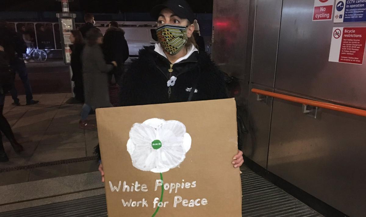 White poppy seller at Dalston Junction railway station in London