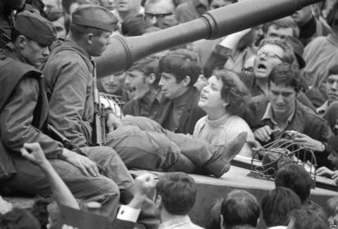 Young Czechoslovak women challenge invading troops in 1968