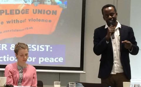Ambrose Musiyiwa addresses the conference, with Amy Clark-Bryan in the chair