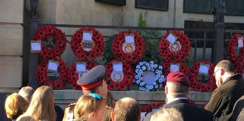 White poppy wreath among the red poppy wreaths in Bath on Sunday